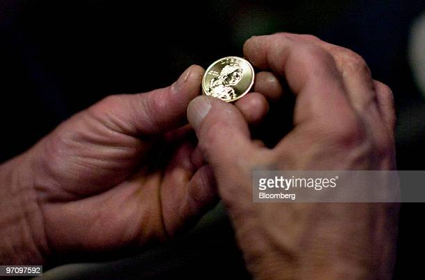 Don Daldo inspects a 2010 Sacagawea dollar coin at the United States Mint in Philadelphia Pennsylvania US on Thursday Feb 25 2010 The US dollar has...