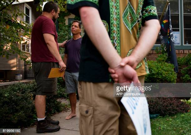 Don Damond fiance of Justine Damond greets demonstrators outside his home on July 20 2017 in Minneapolis Minnesota Several days of demonstrations...