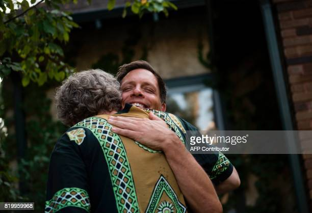 Don Damond fiance of Justine Damond greets Jody Sipe outside his home on July 20 2017 in Minneapolis Minnesota Several days of demonstrations have...