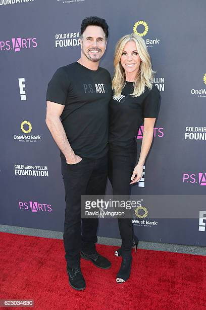 Don Diamont and Cindy Ambuehl arrive at the PS ARTS' Express Yourself 2016 at Barker Hangar on November 13 2016 in Santa Monica California