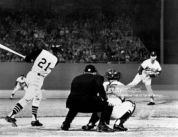 Don Drysdale of the Los Angeles Dodgers pitches to Roberto Clemente of the Pittsburgh Pirates during a season game at Dodger Stadium in Los Angeles...