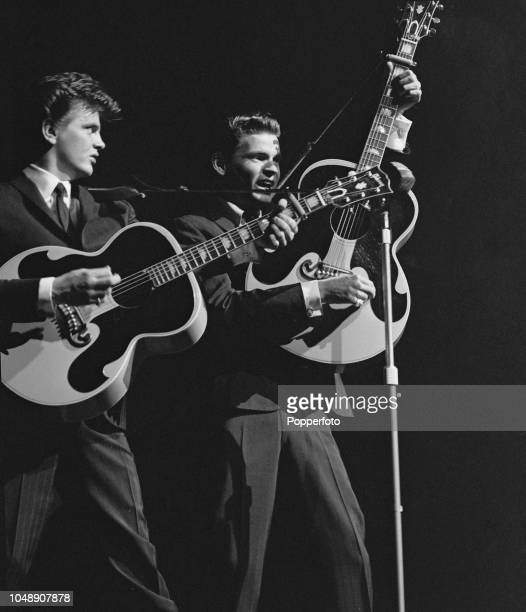 Don Everly and Phil Everly of American rock and roll duo The Everly Brothers perform live on stage together at the New Victoria Theatre in London on...
