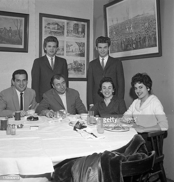 Don Everly and Phil Everly of the rock and roll band The Everly Brothers pose for a portrait with other attendees at a Cadence Records party on April...