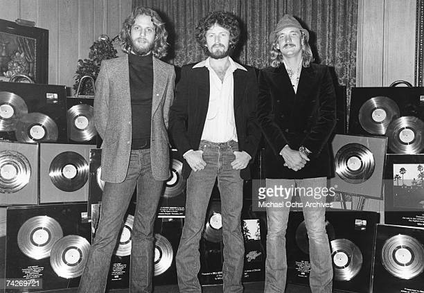 Don Felder Don Henley and Joe Walsh of the rock band Eagles pose for a portrait with a lots of Gold Records in circa 1978