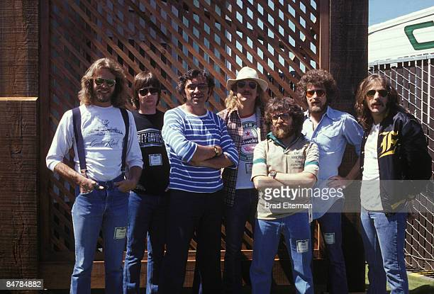 LOS ANGELES MAY 28 1977 Don Felder Randy Meisner Bill Graham Joe Walsh Irving Azoff Don Henley and Glen Fry of The Eagles at Day On The Green concert...