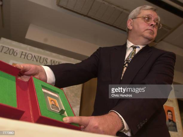 Don Flanagan of Mastronet a sports memorabilia auction company unveils the T206 Honus Wagner baseball card June 6 2000 in New York City The legendary...