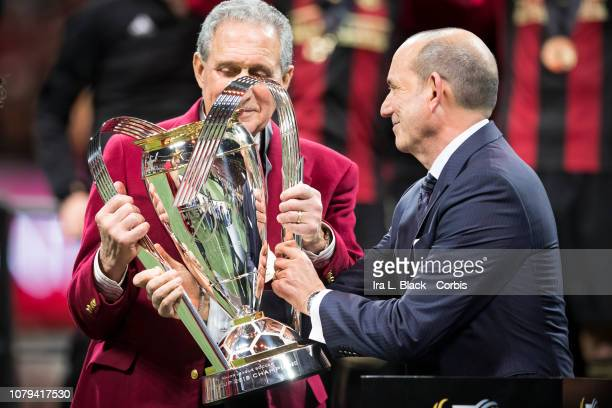 Don Garber, MLS Commissioner presents the Phillip P. Anschutz MLS Championship Trophy to Arthur Blank, owner of the Atlanta Flacons and Atlanta...