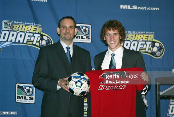 Don Garber MLS Comnissioner and Jordan Stone the Dallas Burn No 15 pick pose for a picture during the 2002 MLS Super Draft on February 10 2002 at the...