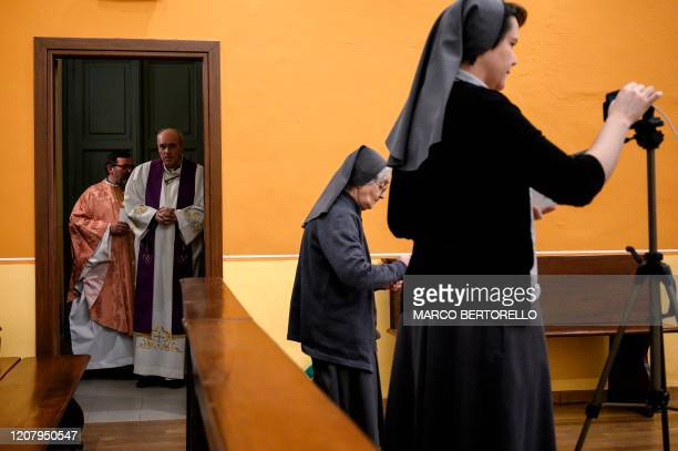 Don Giovanni Banchio and Don Roberto Salomone wait to celebrate the streaming ofSunday mass in the Chapel of the San Giovanni Bosco Oratory on March...