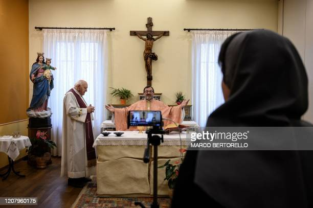TOPSHOT Don Giovanni Banchio celebrates the streaming of Sunday mass in the Chapel of the San Giovanni Bosco Oratory on March 22 2020 in Saluzzo near...