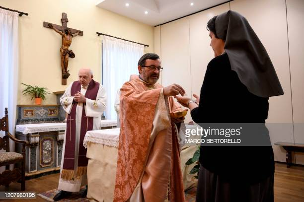 Don Giovanni Banchio celebrates the streaming of Sunday mass in the Chapel of the San Giovanni Bosco Oratory on March 22 2020 in Saluzzo near Cuneo...