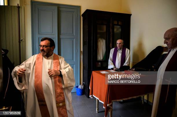 Don Giovanni Banchio Don Roberto Salomone and Don Oreste Franco prepare to celebrate the streaming of Sunday mass in the Chapel of the San Giovanni...