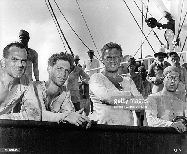 Don Gordon Bill Mumy Steve McQueen and Dustin Hoffman on a prison ship bound for French Guiana in a scene from the film 'Papillon' 1973