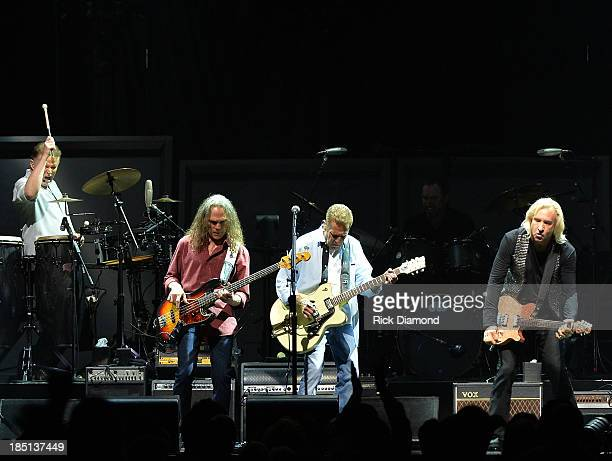 Don Henley, Timothy B. Schmit, Glen Frey and Joe Walsh of the Eagles perform at the Bridgestone Arena on October 16, 2013 in Nashville, Tennessee.