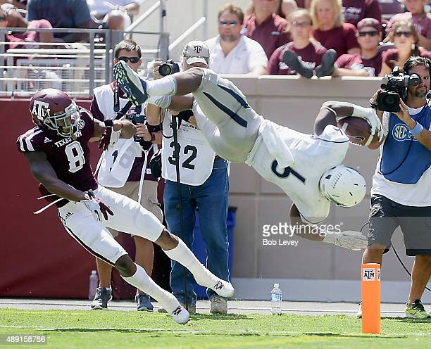 Don Jackson of the Nevada Wolf Pack scores as he is upended by Nick Harvey of the Texas AM Aggies in the fourth quarter at Kyle Field on September 19...