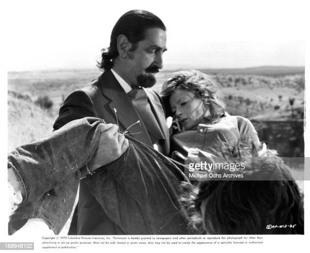 Don Jaime De Mora Y Aragon carries Maggie Smith in a scene from the film 'Love And Pain And The Whole Damn Thing' 1973
