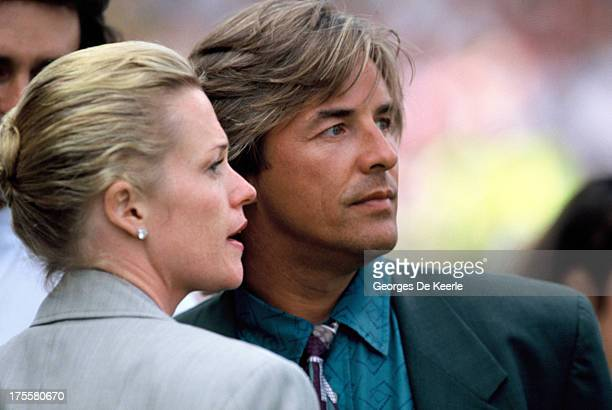 Don Johnson and Melanie Griffith attend the opening ceremony of the European Summer Special Olympics on July 21, 1990 in London, England.