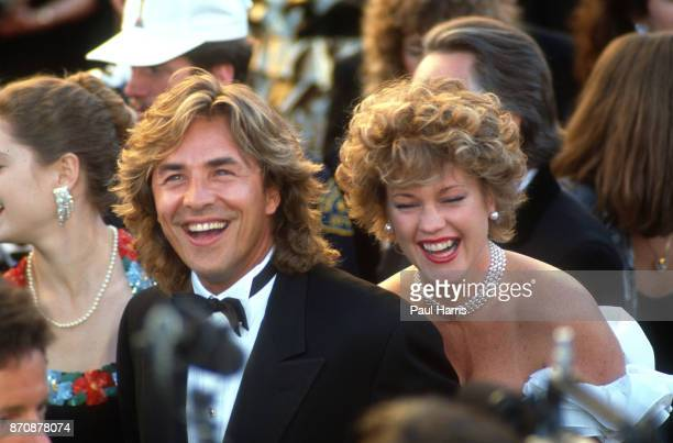 Don Johnson and Melanie Griffiths arrive at the 1989 Oscars April 28 1989 Dorothy Chandler Pavilion Los Angeles California