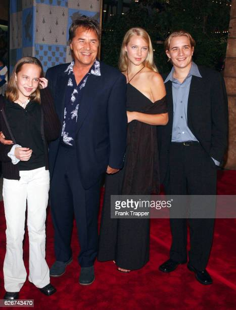 Don Johnson with daughter Dakota and son Jesse with a date at the premiere of Harry Potter and the Sorcerer's Stone