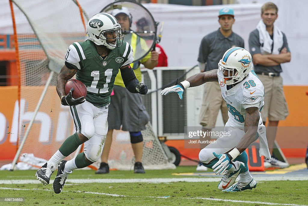 Don Jones #36 of the Miami Dolphins defends against Jeremy Kerley #11 of the New York Jets as he runs with the ball on December 29, 2013 at Sun Life Stadium in Miami Gardens, Florida. The Jets defeated the Dolphins 20-7.