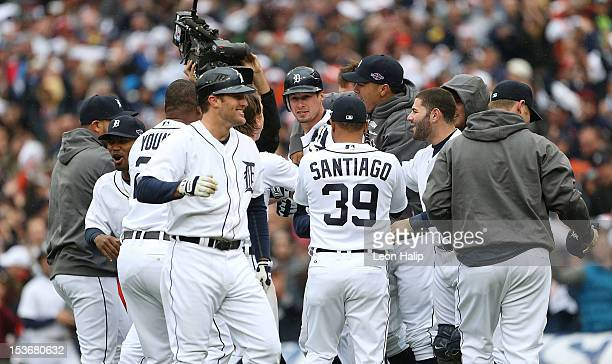 Don Kelly of the Detroit Tigers celebrates with his teammates after hitting a game winning sacrifice fly during Game Two of the American League...
