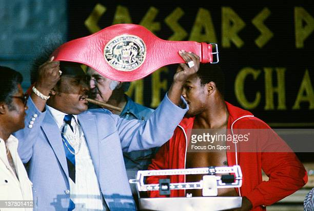 Don King shows off a Championship belt while Larry Holmes weighs in before his WBC heavyweight tittle fight against Mohammad Ali October 2 1980 at...