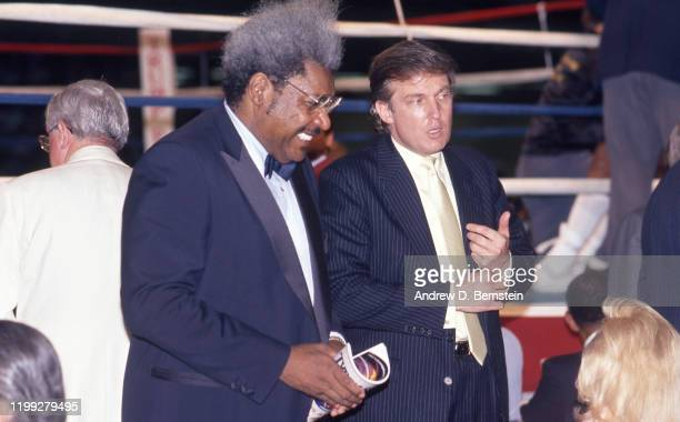 Don King speaks with Donald Trump at the Mike Tyson vs Michael Spinks fight on June 27 1988 in Atlantic City New Jersey