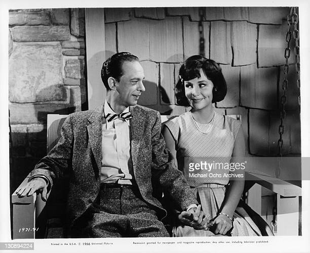 Don Knotts and Joan Staley sitting on bench outside in a scene from the film 'The Ghost And Mr Chicken' 1966