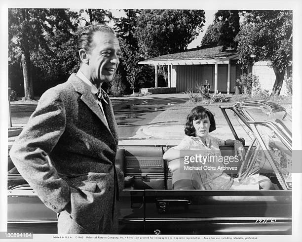 Don Knotts leaning up against car Joan Staley is driving in a scene from the film 'The Ghost And Mr Chicken' 1966