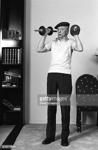 Don Knotts lifting weights at home