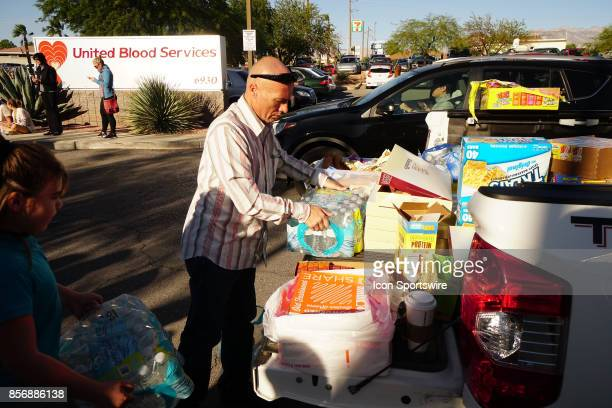 Don Leadbetter and his Daughter Madon donate water at United Blood Services in Northwest Las Vegas NV on October 2 after a mass shooting at the Route...