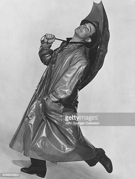 Don Lockwood dances in his raincoat in Singin' in the Rain