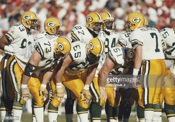 Don Majkowski Quarterback for the Green Bay Packers talks to Ken Ruettgers Rich Moran Blair Bush Stirling Sharpe Herman Fontenot Jeff Query and Alan...