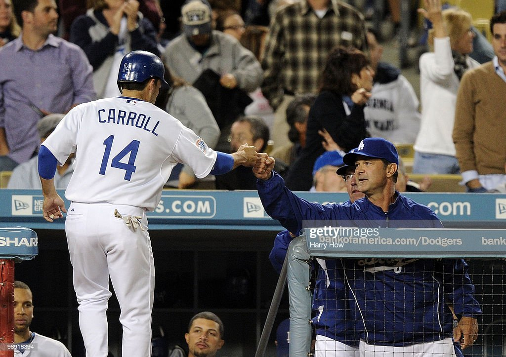 Don Mattingly #8 and Jamey Carroll #4 of the Los Angeles Dodgers celebrate a run for a 6-5 lead over the Colorado Rockies during the sixth inning at Dodger Stadium on May 7, 2010 in Los Angeles, California.