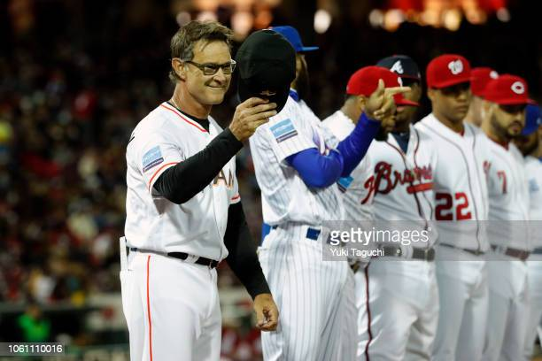 Don Mattingly of the Miami Marlins tips his cap during player introductions prior to Game 4 of the Japan AllStar Series against Team Japan at Mazda...
