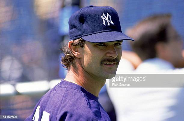 Don Mattingly of the New York Yankees looks on during batting practice prior to a game against the Toronto Blue Jays during the 1988 MLB season at...