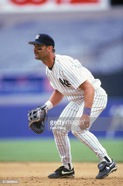 Don Mattingly of the New York Yankees stands ready for a play during a MLB season game at Yankees Stadium on June 24 1995 in Bronx New York