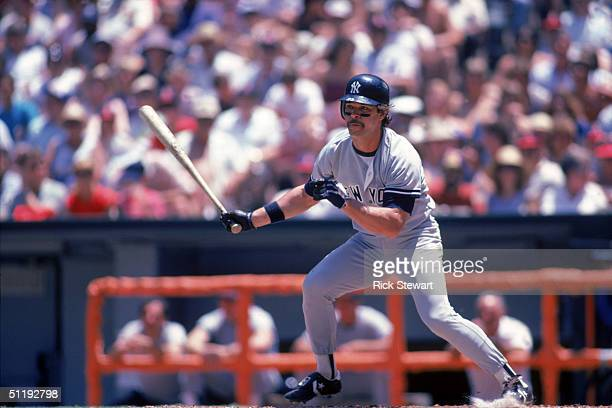 Don Mattingly of the New York Yankees watches the flight of the ball as he prepares to run to first base during a 1986 season game against the...