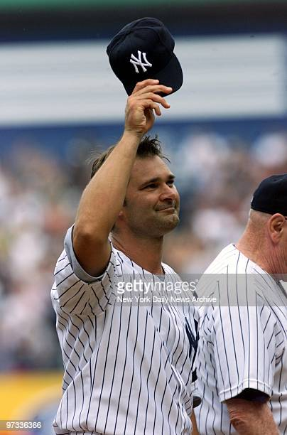 Don Mattingly waves to the crowd at Yankee Stadium during annual OldTimers' Day festivities