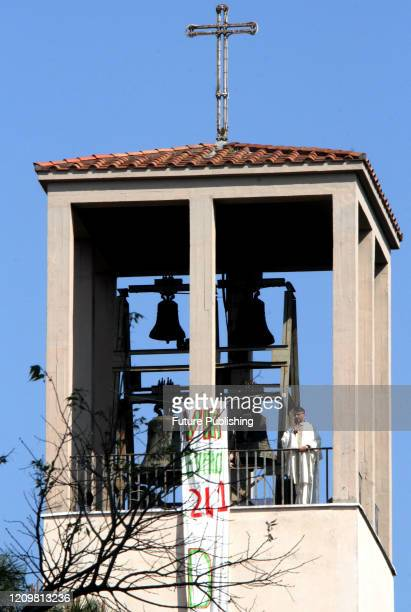 Don Maurizio Mirilli celebrates Easter mass from the bell tower of his church Santissimo Sacramento in Rome PHOTOGRAPH BY Marco Ravagli / Barcroft...