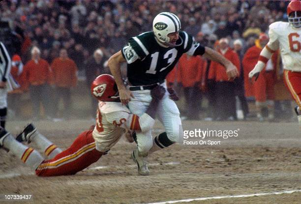 Don Maynard of the New York Jets is dragged down by Jim Marsalis of the Kansas City Chiefs during and NFL football game at Shea Stadium circa 1969 in...