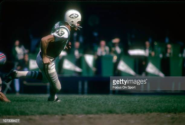 Don Maynard of the New York Jets runs with the ball after a catch against the Houston Oilers during and NFL football game at Shea Stadium circa 1969...