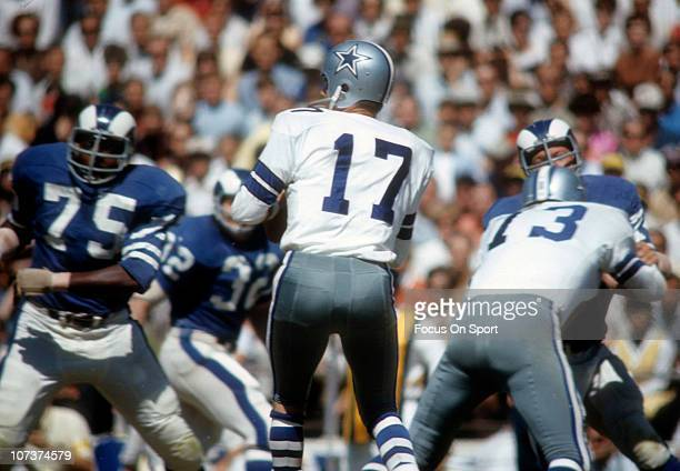 Don Meredith of the Dallas Cowboys drops back to pass against the Los Angeles Rams during an NFL football game at the Cotton Bowl circa 1967 in...