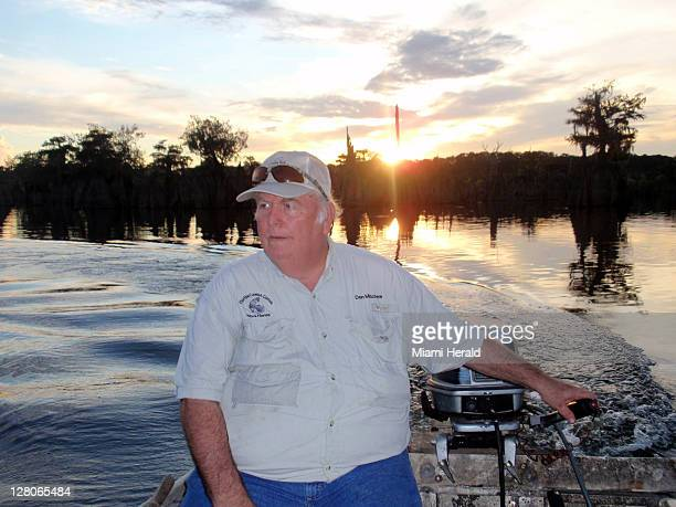 Don Minchew heads his skiff on the Chipola River in Wewahitchka Florida in search of flathead catfish The fish is ugly but tastes great so state...