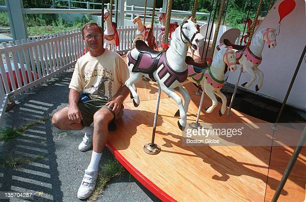 Don Moore of Lowell sits on his labor of love a carousel which he found sitting in pieces badly damaged by Hurricane Hugo on a Virginia farm in 1992...