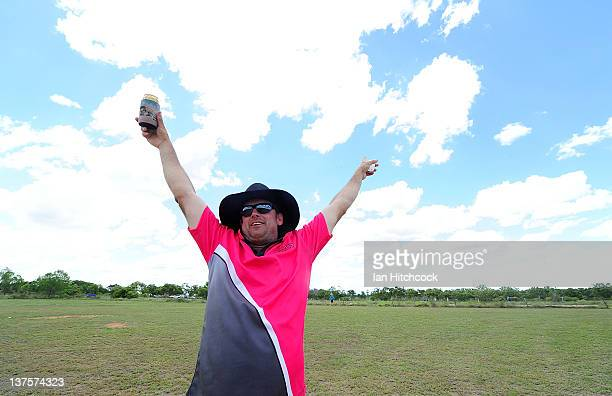 Don Moxham from the team 'Tuggers' signals a six during the 2012 Goldfield Ashes cricket competition on January 22 2012 in Charters Towers Australia...