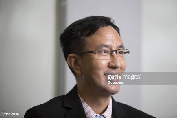 Don Nakornthab senior director of the economic and policy department at the Bank of Thailand reacts during an interview in Bangkok Thailand on...