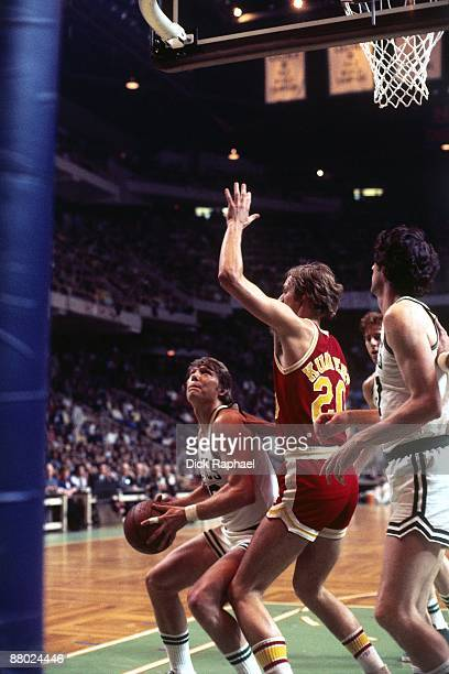 Don Nelson of the Boston Celtics gets in position to shoot against Kevin Kunnert of the Houston Rockets during a game played in 1975 at the Boston...
