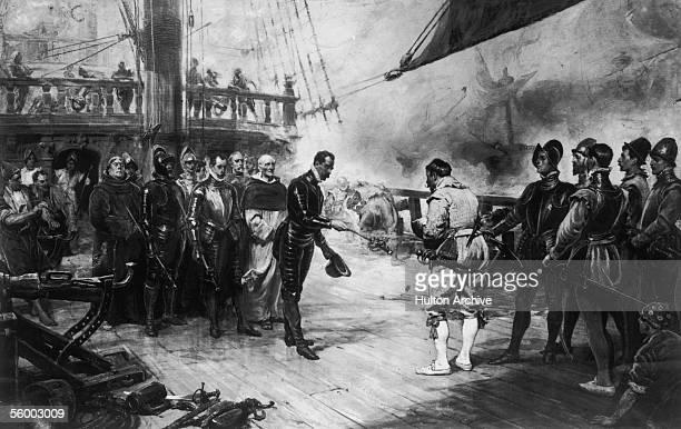 Don Pedro de Valdes Admiral of the Spanish flagship Nuestra Senora del Rosario surrenders his sword to Sir Francis Drake of the British navy on board...