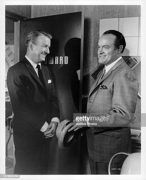 Don Porter and Bob Hope reflect forced cheerfulness in a business meeting in a scene from the film 'Bachelor In Paradise' 1961